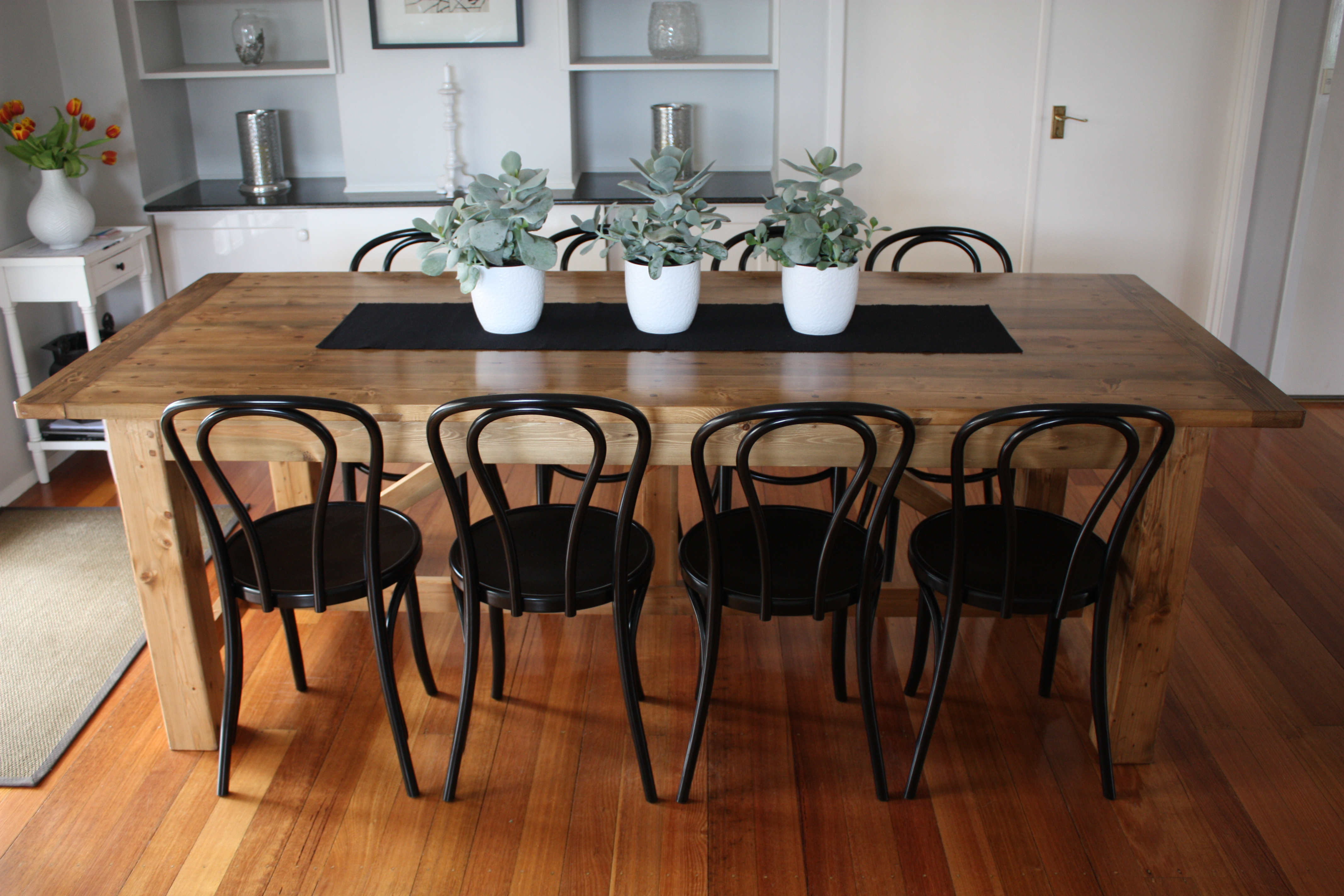 Full Length Shot Showing 8 Bentwood Chairs All Lined Up Neatly